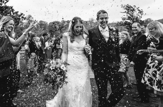 confetti thrown on newlyweds