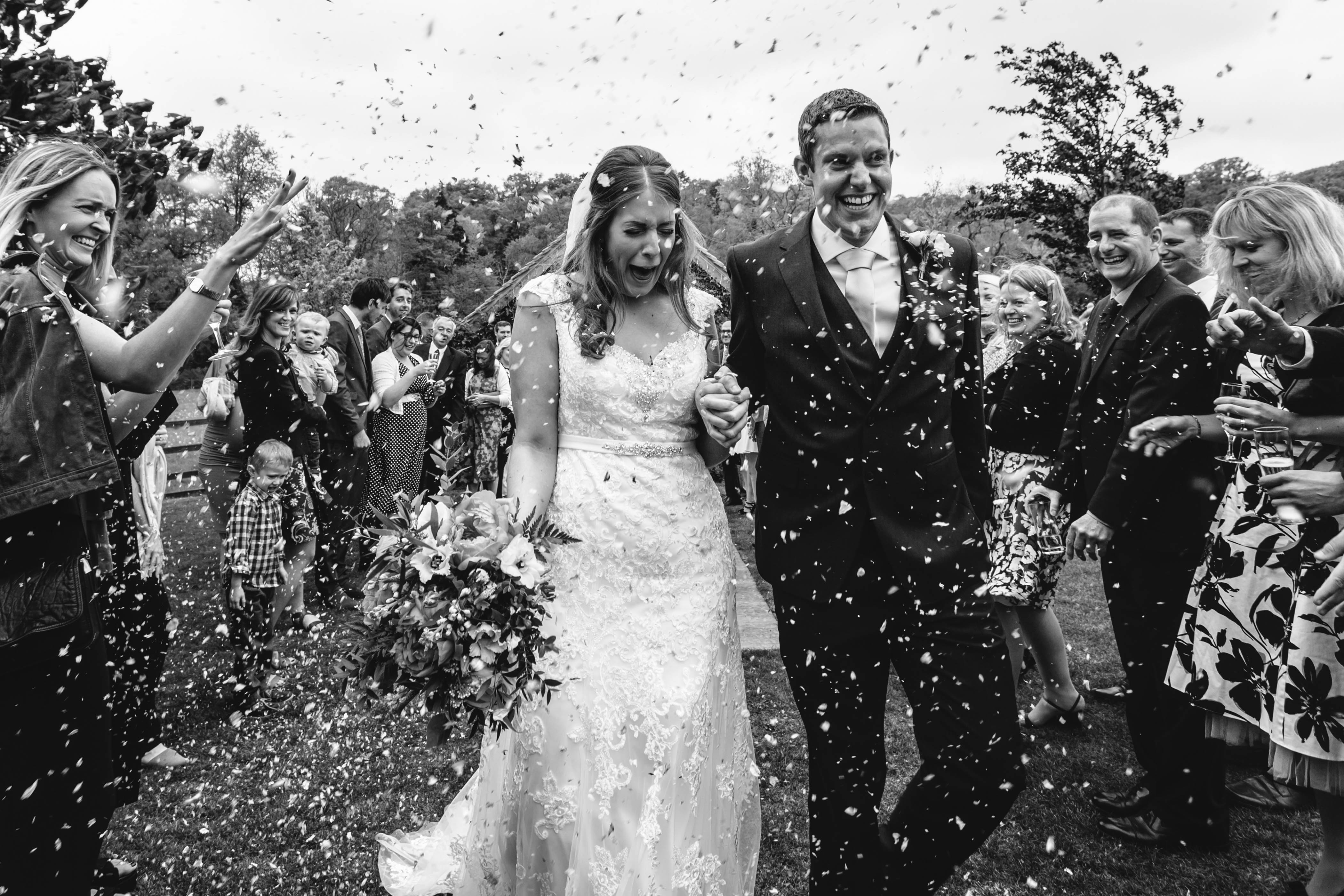 confetti thrown on newlyweds