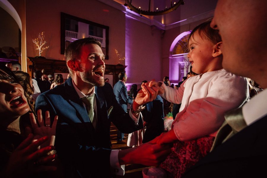 best man dancing with child