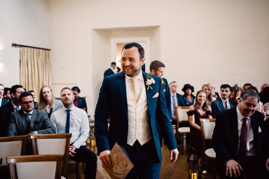groom arriving to ceremony room