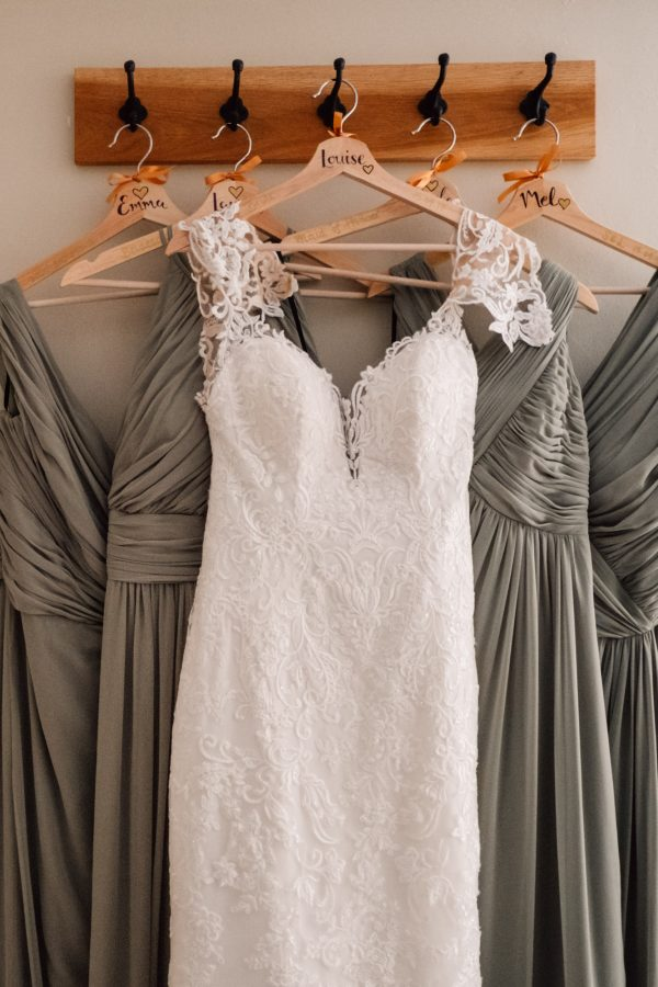 brides and bridesmaids dresses hanging