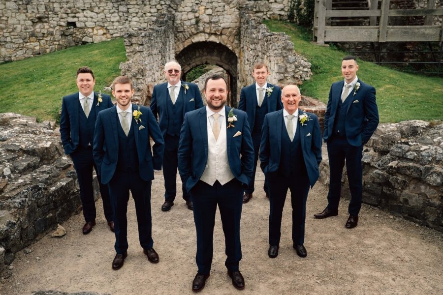 groomsmen stood by ruins
