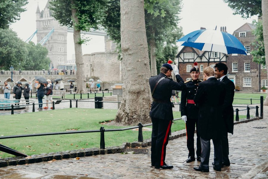 groomsmen in the rain at the tower of london