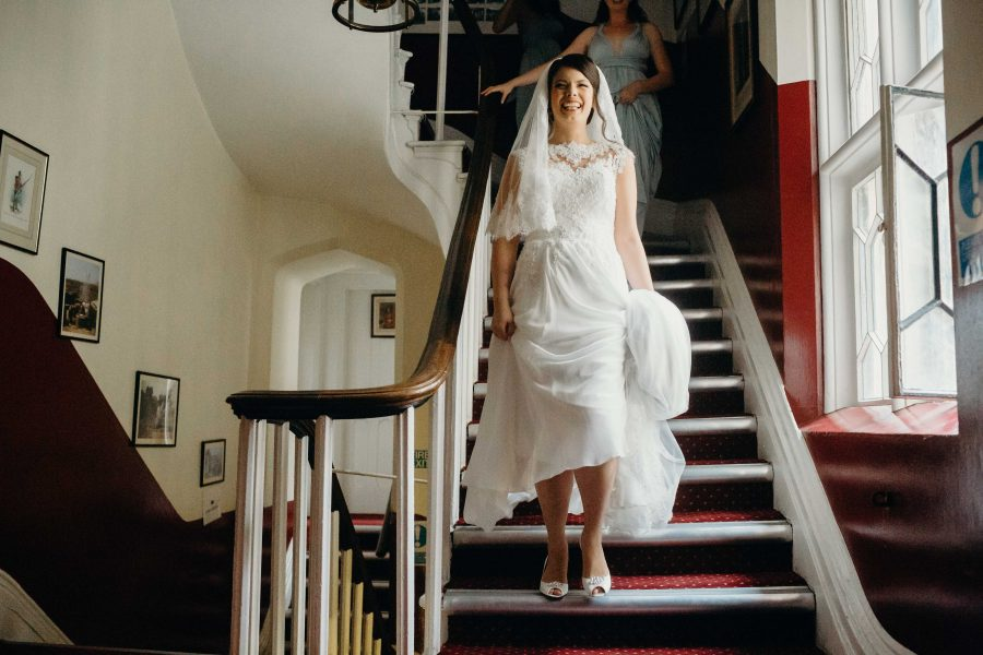 Bride descending the stairs before her wedding at the tower of london