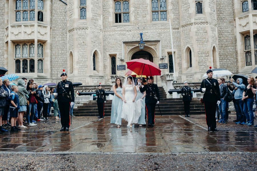 bride being escorted by honour guard to wedding at the tower of london