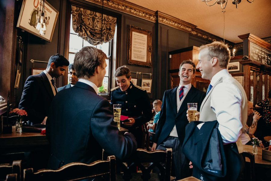Groomsmen drinking before the wedding at the hung drawn and quartered
