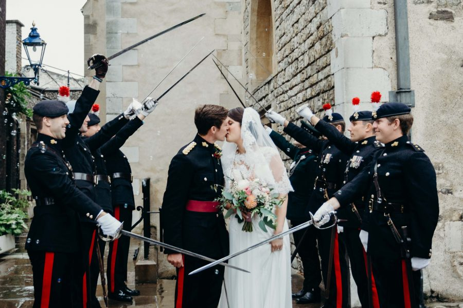 couple kiss in the guard of honour at the tower of london