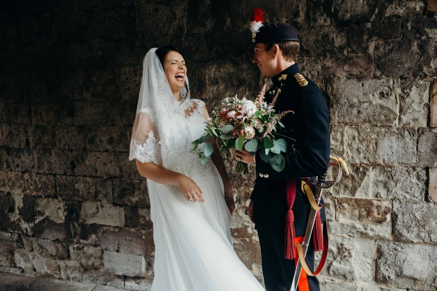 laughing during bridal portriats at the Traitor's gate at the Tower of London
