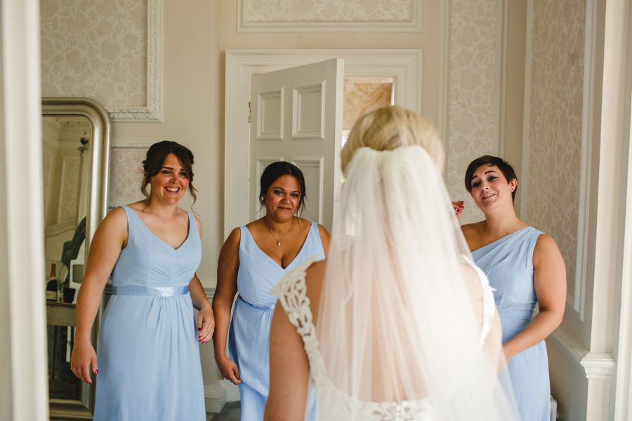 bridesmaids first look at bride in veil
