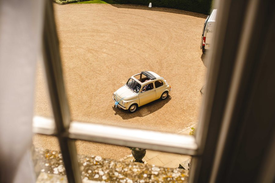 fiat 500 wedding car arriving at hedsor house