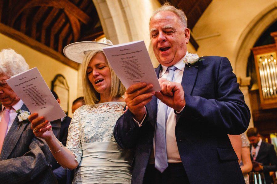 wedding guests singing in church