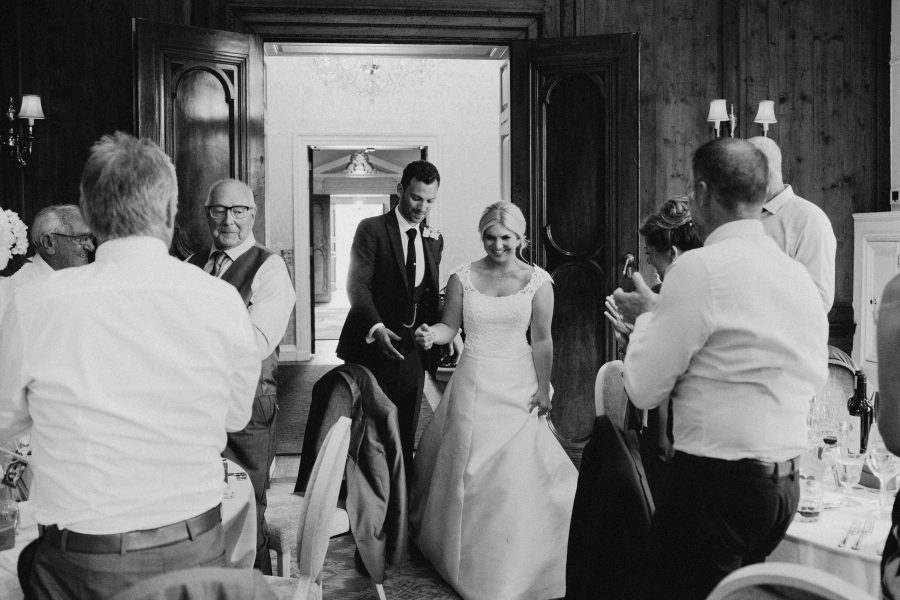 Bride and Groom entering wedding breakfast at Hedsor House
