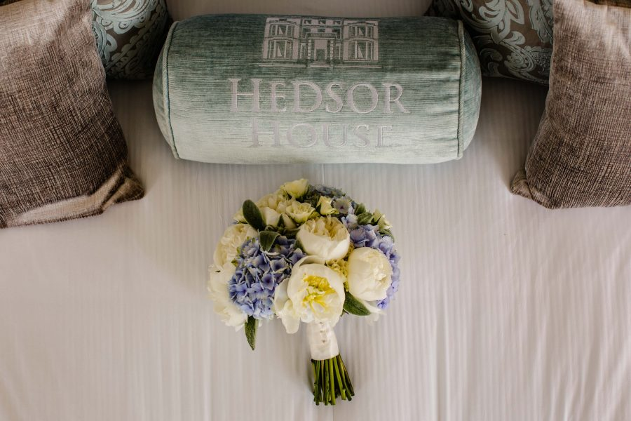 wedding bouquet on bed by hedsor house cushion