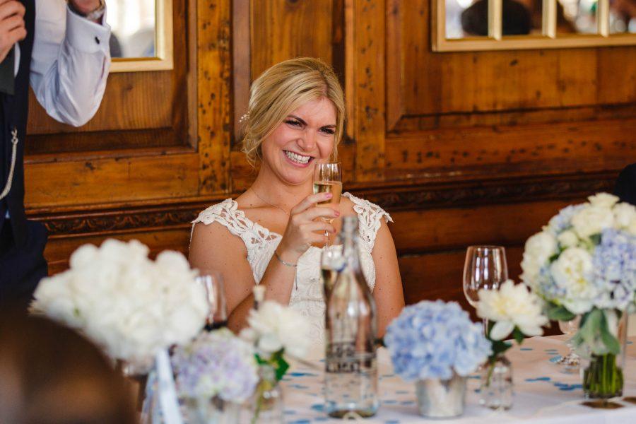bride raising a toast during speeches