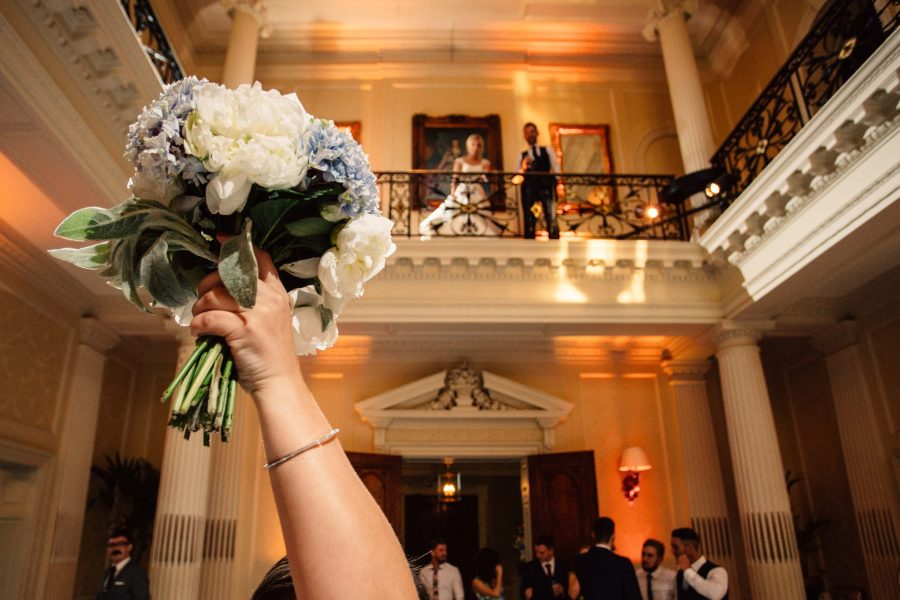 catching the wedding bouquet at Hedsor House