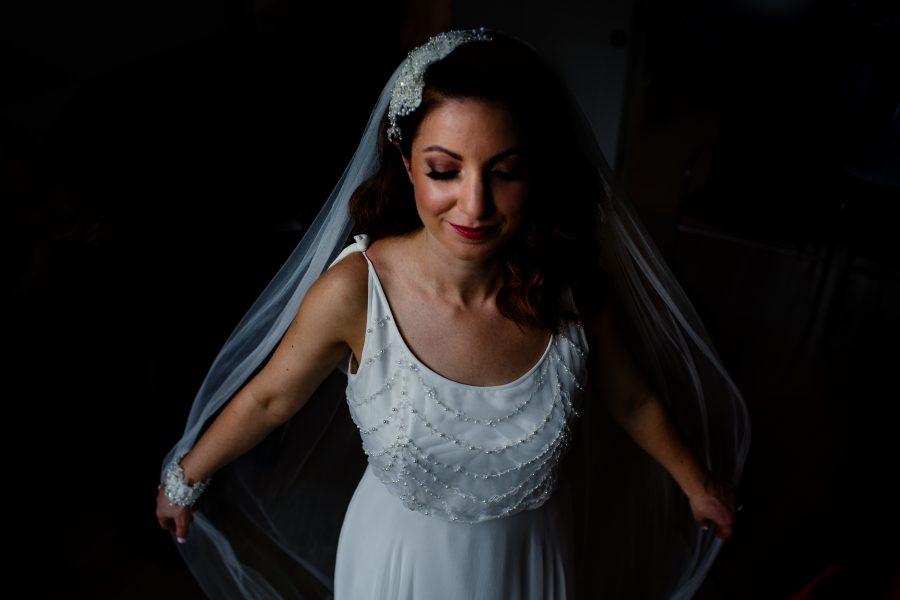 bride showing off veil