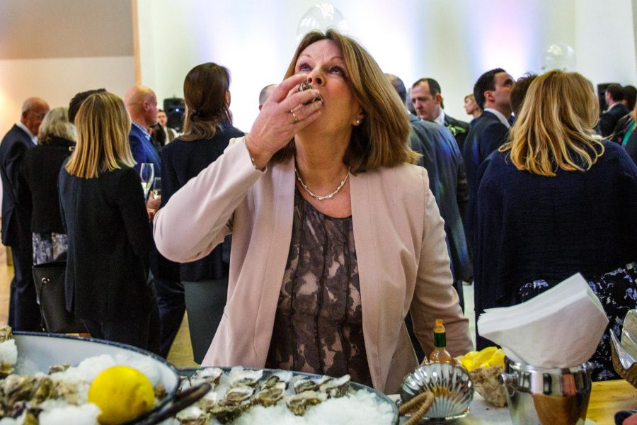 wedding guest eating an oyster