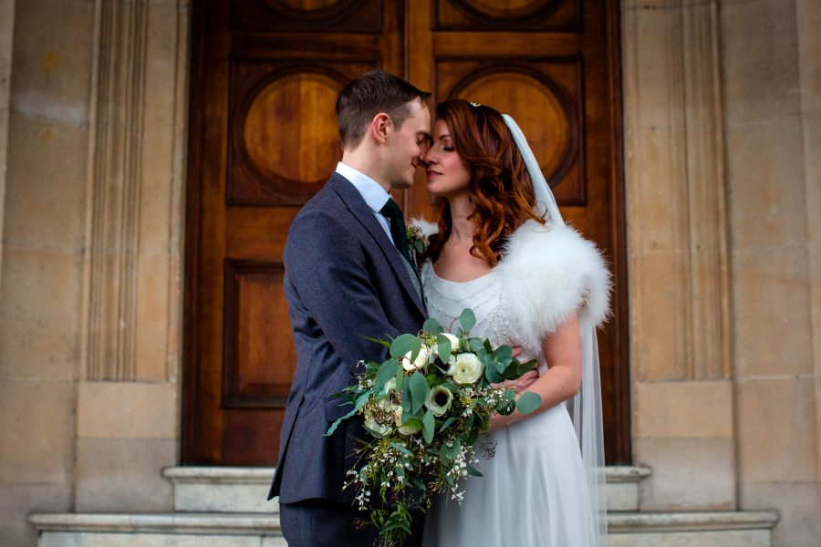 bridal couple kiss outside sunbeam studios