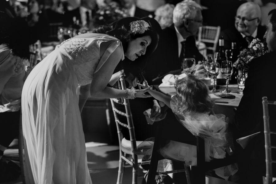 bride greeting guests during wedding breakfast