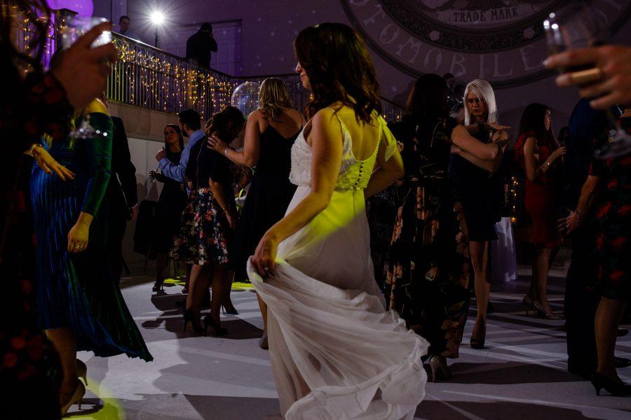 bride swishing her dress and dancing