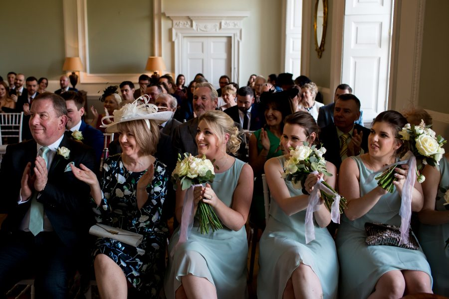 clapping bridesmaids after vows