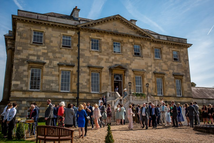 Botleys Mansion wedding guests outside in sunshine