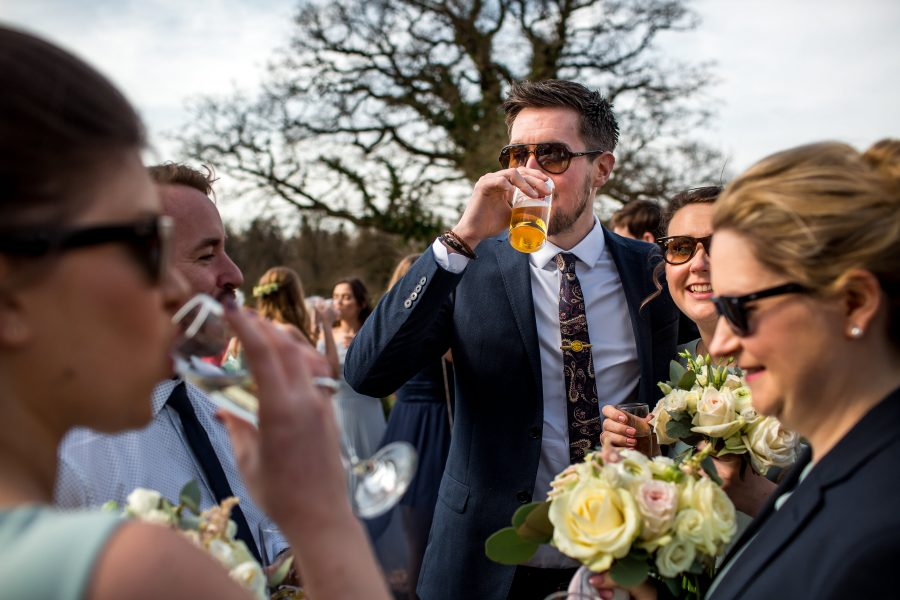 wedding guests drinking in the sun