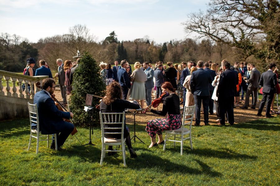 Wedding guests on the lawn at Botleys Mansion