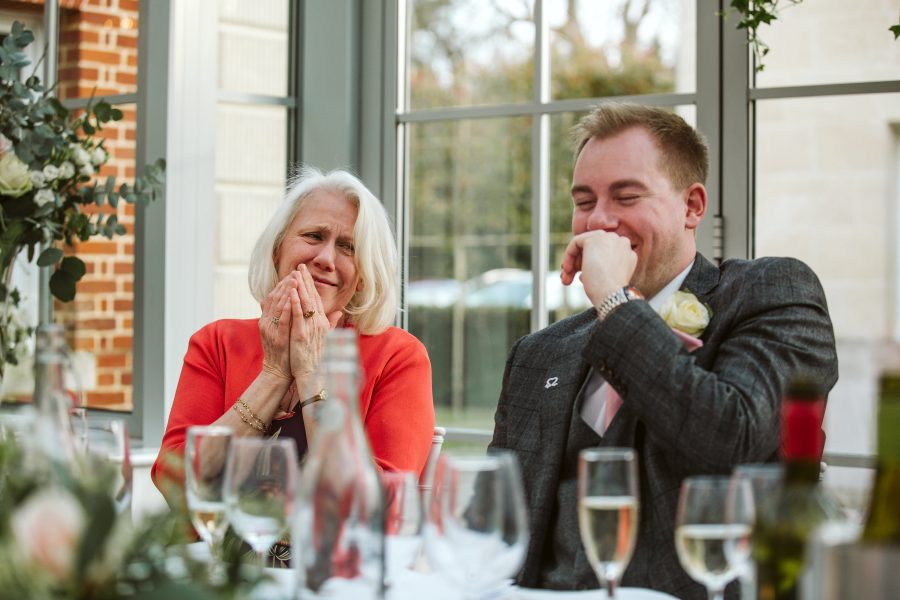 groom and mother of groom laughing during speeches
