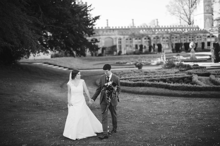 bride and groom in front of Ashridge House
