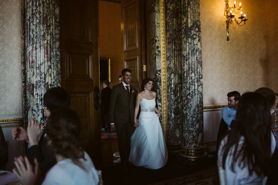 bride and groom entering wedding breakfast at Ashridge House