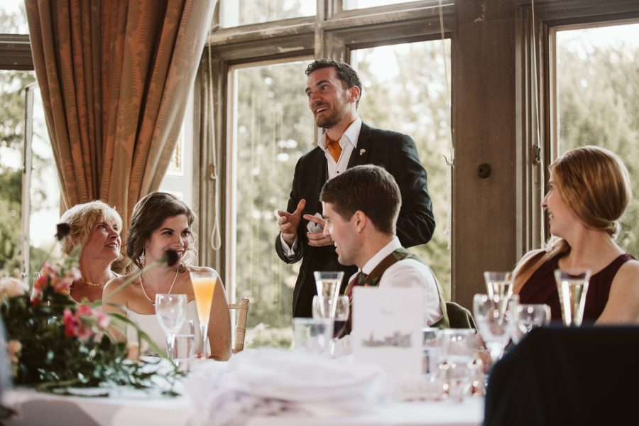 magician showing trick to bride and groom