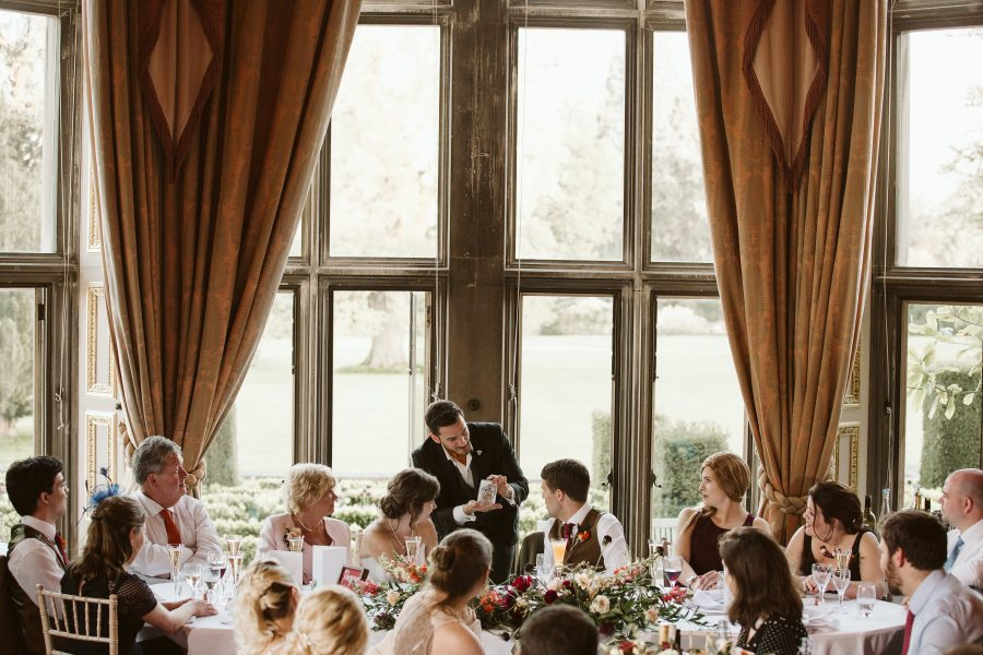 magician showing trick during wedding breakfast