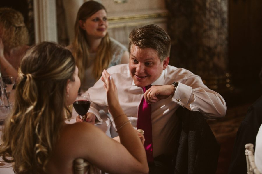 wedding guests chatting during speeches