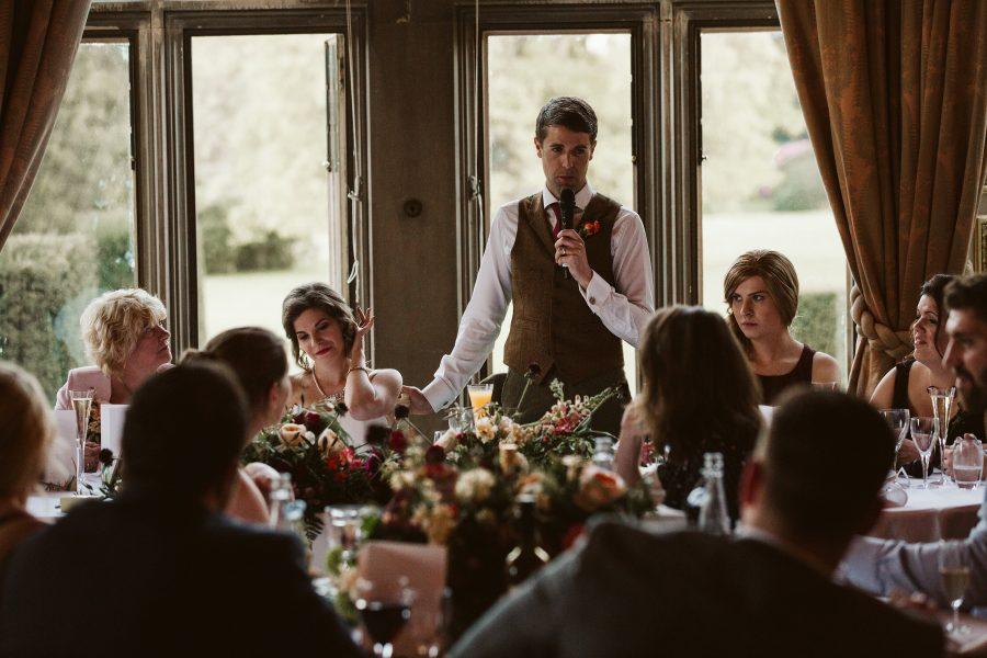 groom giving speech at his wedding reception at Ashridge House