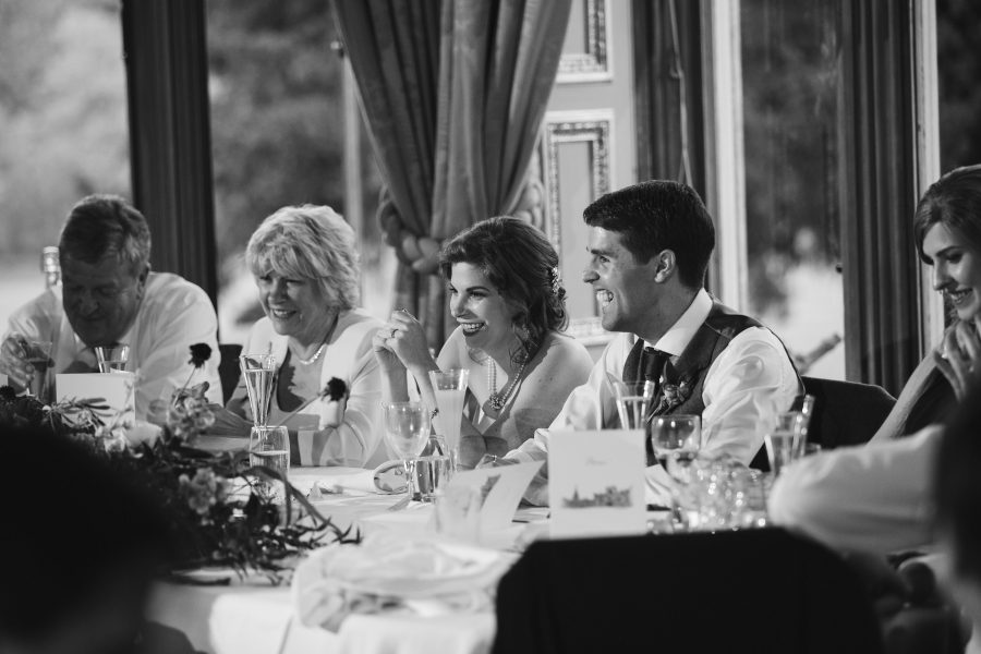 bride and groom laughing during speeches