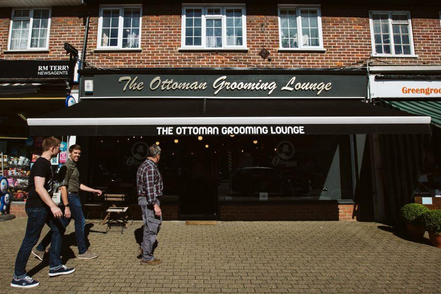 Groomsmen arriving at barbers