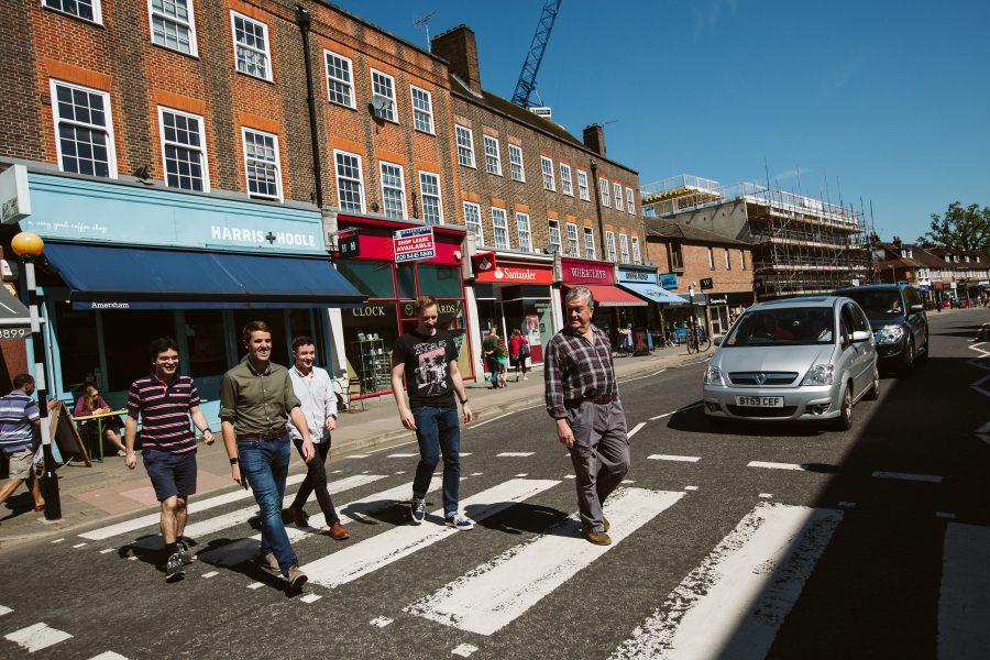 groomsmen crossing the road