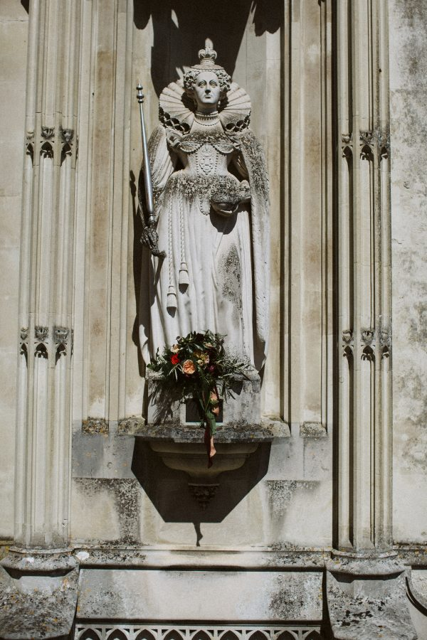 wedding flowers on statue at Ashridge House