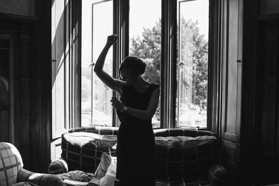 bridesmaid applying deodorant