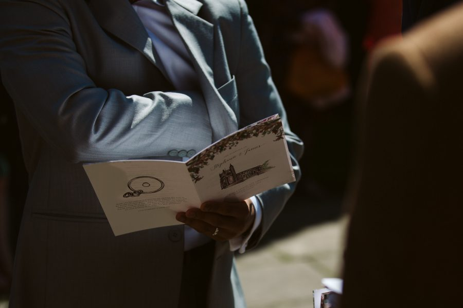 groomsmen checking rings