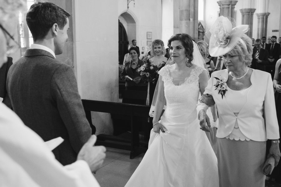 Bride arriving at alter