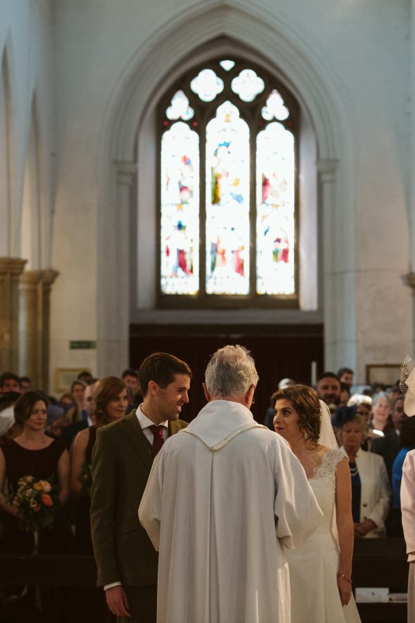 bride and groom saying vows at st mary's church amersham