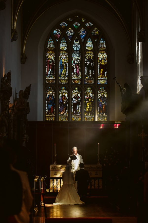 light on couple at alter in church