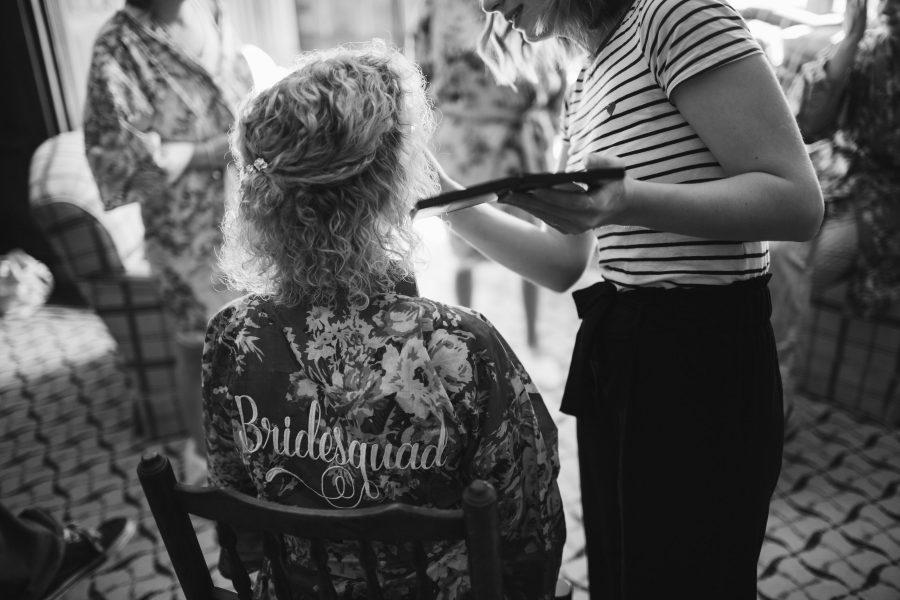 bridesmaid having make up applied