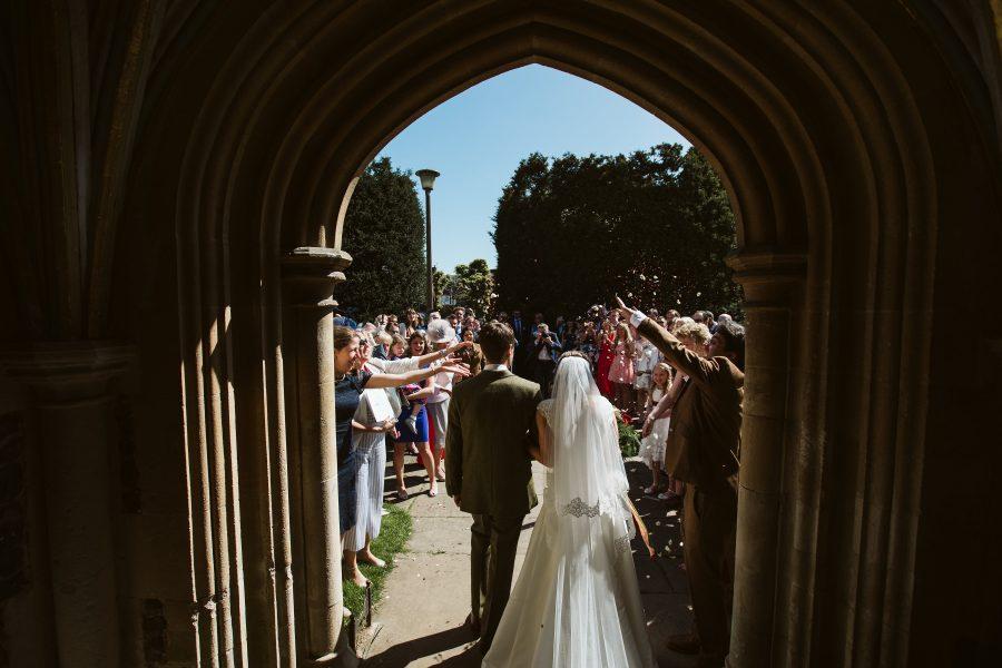 bridal couple leaving church