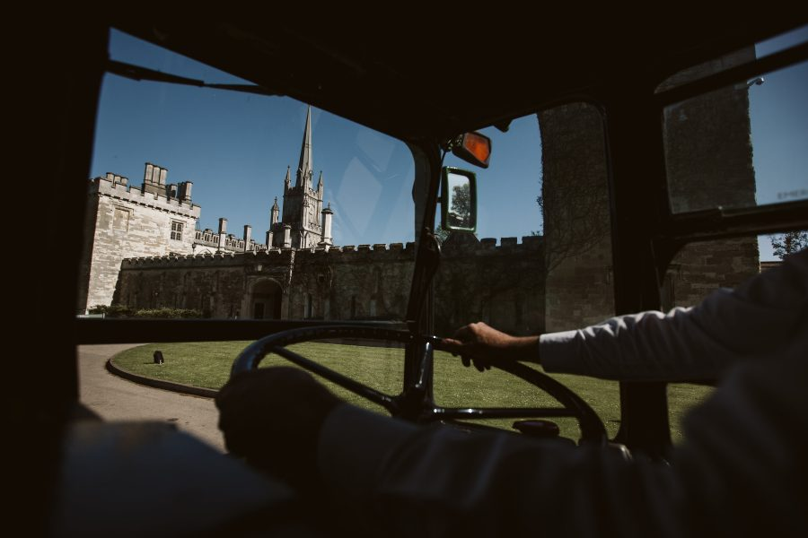 Wedding guests arriving on bus at Ashridge House