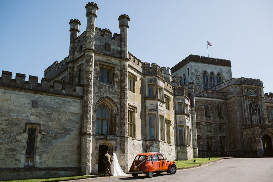 bride and groom arriving at ashridge House in Citroen CV