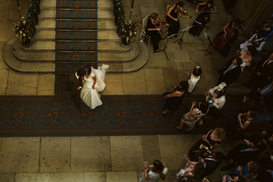 bride and groom descending the staircase at Ashridge house