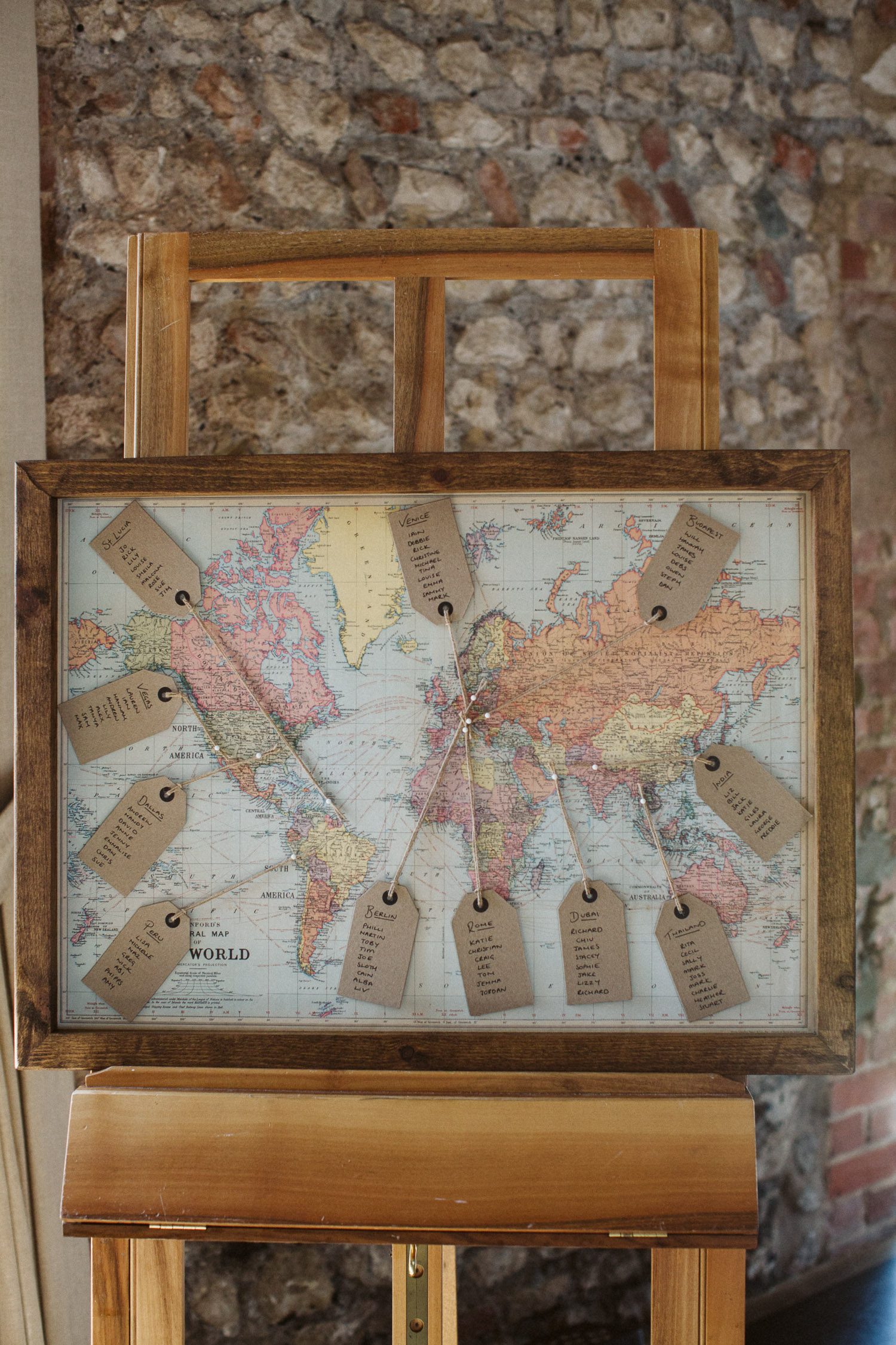 table arrangement decorated with world map and luggage tags